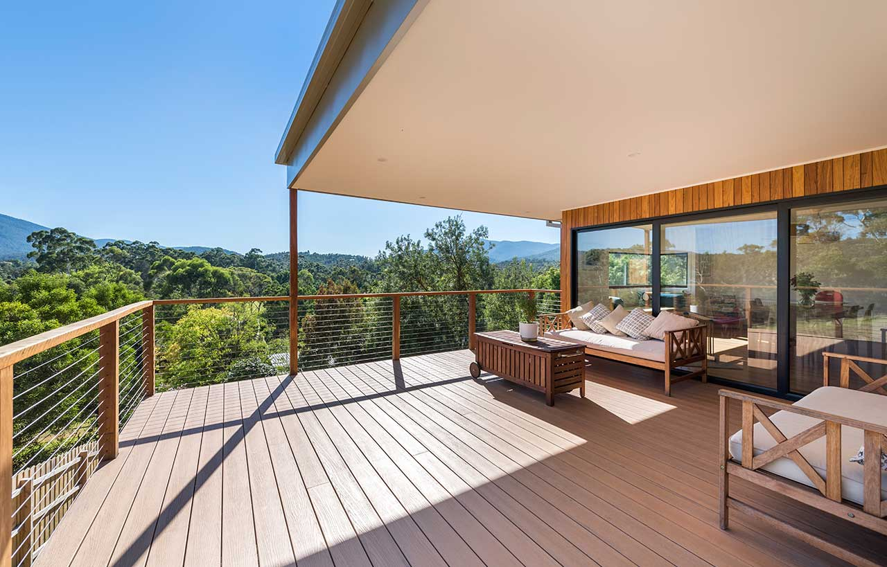sloping block timber home